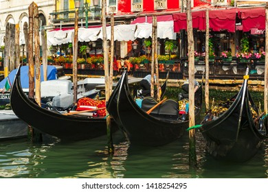 Venice / Italy - 05.25.2019: gondoliers clean the gondolas in the Grand Canal