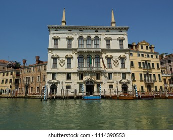 Venice, Italy - 06/05/2018: Exterior facade of an ancient palace or palazzo on the Grand Canal, Venice, Italy with private moorings in front