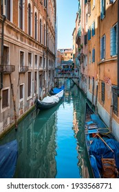 Venice, Italy, 07.04.2019 view of narrow venetian canal and Ponte dei Dai bridge