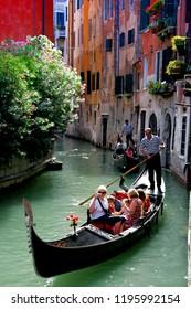 VENICE, ITALY - 07.05.2007: Traditional Venetian gondolas and gondolier in a Venice Canal, Venice, Italy