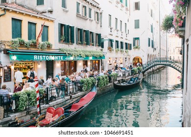 Venice, Italy - 08.12.2016 People eating in restaurant on the street near the grand canal