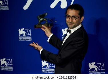 Venice, Italy. 09 September, 2017.   Alireza Khatam poses with the Orizzonti Award for Best Screenplay Award for 'Los Versos Del Olvido' (Oblivion Verses) at the Award Winners photocall