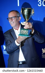 Venice, Italy. 09 September, 2017.    Kamel El Basha poses with the Coppa Volpi for Best Actor Award for The Insult (L'Insulte) at the Award Winners photocall during the 74th Venice Film Festival