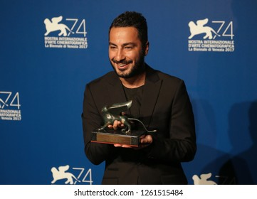 Venice, Italy. 09 September, 2017. Navid Mohammadzaeh  wins Orizzonti prize for the Best Direction with the movie 'Bedoune Tarikh, Bedoune Emza' during Ceremony Awards of the 74th Venice Film Festival