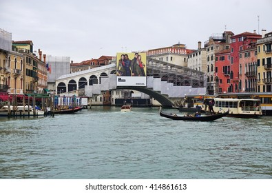 VENICE, ITALY -10 MARCH 2016- The landmark Ponte di Rialto bridge over the Grand Canal in Venice is under a scaffolding as it is undergoing repairs and construction.