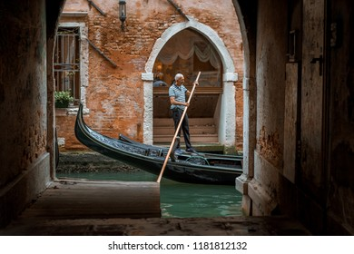 Venice, Italy, 10.09.2018. Historical architecture and landmarks in Venice old town. Narrow streets with colorful buildings surrounded by tourists. Gondola rides in canal with beautiful scenery.