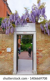VENICE, ITALY -13 APR 2019- View of the Peggy Guggenheim Collection, a modern art museum housed in the Palazzo Venier dei Leoni on the Grand Canal in Venice.
