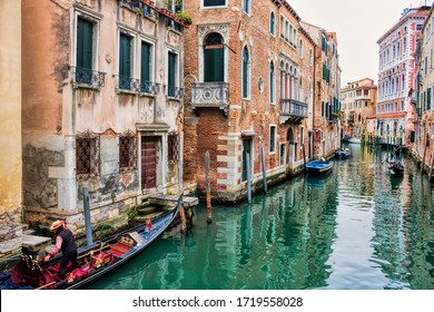 Venice, italy - 13.03.2019 - picturesque canal with gondolas