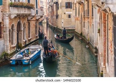 Venice, Italy - 13.03.2019: Venetian canal with gondolas and historic houses. Travel.