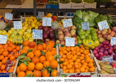 VENICE, ITALY - 14TH MARCH 2015: Fresh fruit and vegetables at a market stall in Venice. People can be seen.