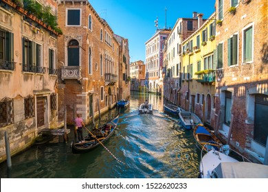 Venice, Italy - 15.08.2019: Traditional gondolas in venetian water canal in Venice. Beautiful turistic place. Travel.
