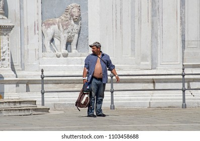VENICE, ITALY - 16 MAY 2018: Man with open shirt just outside of the Hospital in Campo Santi Giovanni e Paolo square