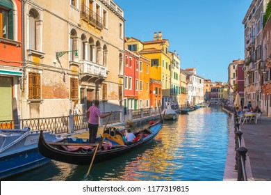 Venice, Italy - 16.08.2018: Tourists travel on gondolas at canal Venice, Italy.
