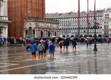 VENICE, ITALY - 17 MARCH 2018: St. Marks Square (Piazza San Marco) during high tide (acqua alta) flood.