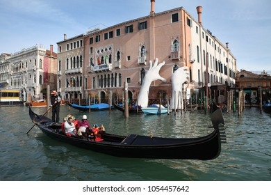 VENICE, ITALY - 18 MARCH, 2018: Gondola with gondolier and tourists in Venice, Italy