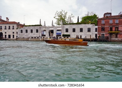VENICE, ITALY -20 APR 2017- View of the Peggy Guggenheim Collection, a modern art museum housed in the Palazzo Venier dei Leoni on the Grand Canal in Venice.
