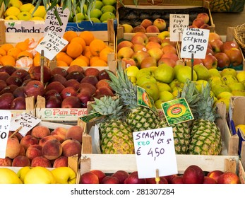 Venice, Italy - 20 May 2105: Rialto fish markets. Fishmonger at work. May 2015: Rialto Market - fruit on sale at market