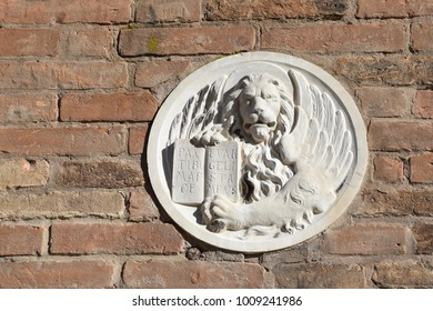 Venice Italy - 22 January 2018 Marble lion of San Marco on brick wall