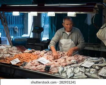 Venice, Italy - 22 May 2105: Rialto fish markets. Fishmonger at work.