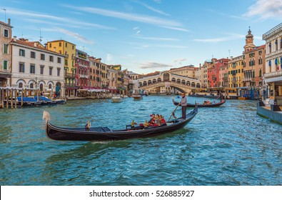 VENICE, ITALY - 22 OCTOBER 2016 - The city on the sea. Here gondola with tourists on the Grand Canal under Rialto Bridge.