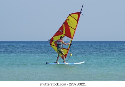 VENICE ,ITALY 28 AUGUST 2014 : A boy carries on his windsurfing. During the summer this is a very popular activity in the seaside resorts