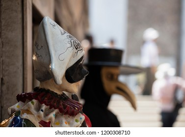 VENICE, ITALY 29TH JULY 2018 - A life-size model of Harlequin / Arlecchino a stock character in the Commedia dell'arte outside a shop in Venice.