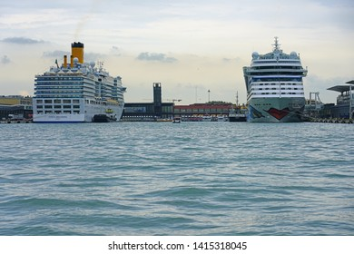 VENICE, ITALY -7 APR 2019- View of the large Aida and Costa Deliziosa cruiseships at the cruise ship terminal dock in Venice. Venetians are protesting large cruise ships as damaging to Venice.