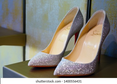 VENICE, ITALY -8 APR 2019- View of expensive high heel pump shoes by luxury footwear brand Christian Louboutin for sale in a store in Venice.