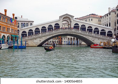 VENICE, ITALY -8 APR 2019- View of the landmark Ponte di Rialto bridge over the Grand Canal in Venice.  Extensive restoration and repairs were finished in January 2017.