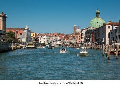 VENICE, ITALY - 9.04.2017: Main street with canal, bridge, boats and tourists in Venice, Italy