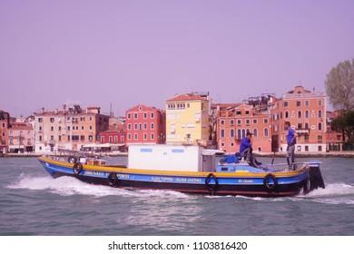 VENICE, ITALY - APR 16, 2018 - Cargo boat in the lagoon of Venice, Italy