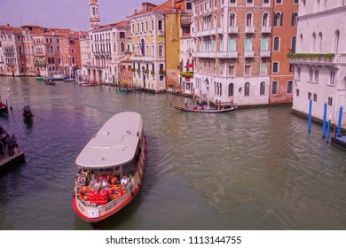 VENICE, ITALY - APR 16, 2018 - Vaporetto cruises down the Grand Canal of Venice, Italy