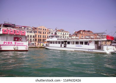 VENICE, ITALY - APR 16, 2018 - Tour boat on the Grand Canal near the Doge's Palace, Venice, Italy
