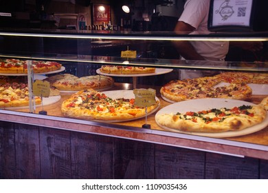 VENICE, ITALY - APR 16,2018 - Fresh pizza in restaurant window, Venice, Italy