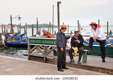 VENICE, ITALY - APR 30 2011:Italian Gondoliers in Venice, Italy.In 17th and 18th century there were about 10,000 gondolas, today there are just over 400 in active service all of them used for tourism.
