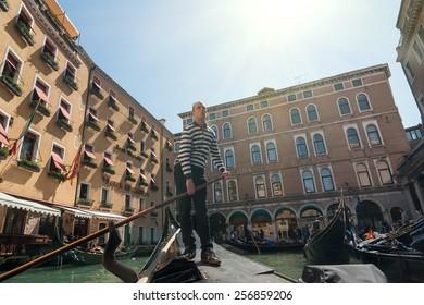 VENICE, ITALY - APRIL 13: Gondolier depart from gondola station, Venice, Italy, April 13, 2013