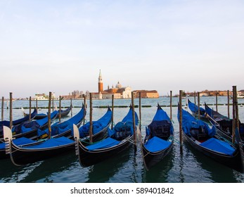 Venice, Italy - April 15, 2015: View of Venice Lagoon with gondolas berthed and Basilica di San Giorgio Maggiore on the background, Venice, Italy