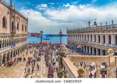 VENICE, ITALY - APRIL 29: Aerial view of tourists visiting the iconic Piazza San Marco (St. Mark's Square), social, religious and political centre of Venice, Italy, April 29, 2018