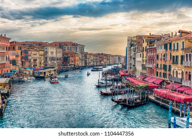 VENICE, ITALY - APRIL 29: Scenic view of the Grand Canal at sunset from the iconic Rialto Bridge, one of the major landmark in Venice, Italy, as seen on April 29, 2018