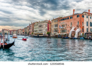 """VENICE, ITALY - APRIL 29: The scenic monumental sculpture of a child's hands called """"Support"""" by Lorenzo Quinn, installed in the Grand Canal of Venice, Italy, as seen on April 29, 2018"""