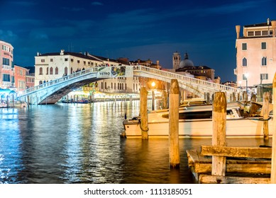 VENICE, ITALY - APRIL 29: Tourists walking on the Ponte degli Scalzi (also known as Railway Bridge) in Venice, Italy on April 29, 2018. It is one of only four bridges to span the Grand Canal