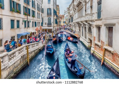 VENICE, ITALY - APRIL 29: Traditional Gondolas with scenic architecture along the canal Rio de Palazzo, in San Marco district of Venice, Italy, April 29, 2018
