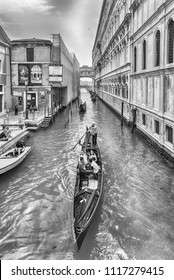 VENICE, ITALY - APRIL 29: Traditional Gondolas with scenic architecture of the iconic Bridge of Sighs, one of the major landmark and sightseeing in Venice, Italy, April 29, 2018
