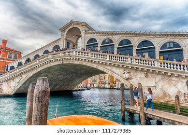 VENICE, ITALY - APRIL 29: View of Rialto Bridge, iconic landmark in Venice, Italy, April 29, 2018. It is the oldest of the four bridges spanning the Grand Canal and a major sightseeing of the city