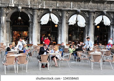 VENICE, ITALY - APRIL 30 2011:People dinning in a restaurant in St Mark's Square, Venice Italy.Each year Venice receives 18 million tourists. This equates to approximately 50,000 visitors each day