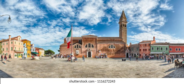 VENICE, ITALY - APRIL 30: Panoramic view of the main square of Burano island, Venice, Italy, April 30, 2018. This square is also the location of St Martin's Church, iconic landmark of the city
