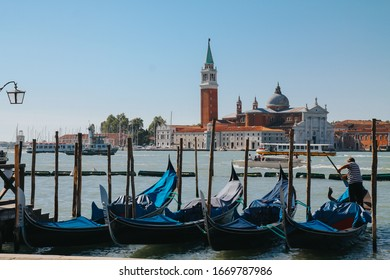 VENICE, ITALY -APRIL 8: Gondolas and tourists on April 8, 2019 in Venice, Italy. Venice has an average of 50,000 tourists a day.
