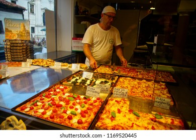 VENICE, ITALY - AUG 10, 2018 - Pizza in a restaurant in Venice, Italy