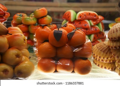 VENICE, ITALY - AUG 10, 2018 - Marzipan pastries in fruit and fish shapes in pastericcia in Venice, Italy