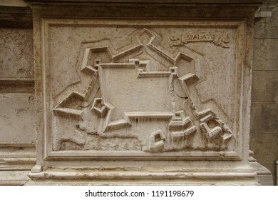 VENICE, ITALY - AUG 10, 2018 - Bas Relief map of fortifications of the city of Spoleto on exterior of church in Venice, Italy